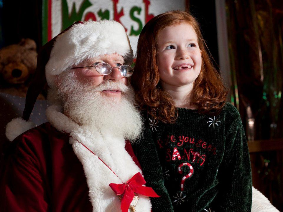 A young girl visits with Santa