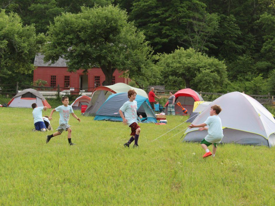 Cup scouts play in the field where their tents are set up