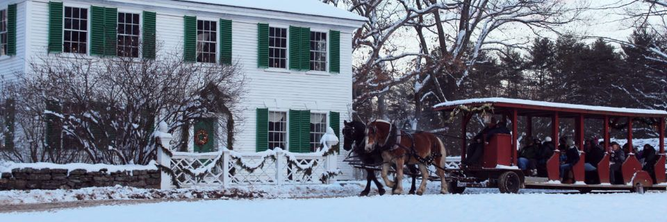 Horse-drawn wagon outside the Salem Towne House in winter