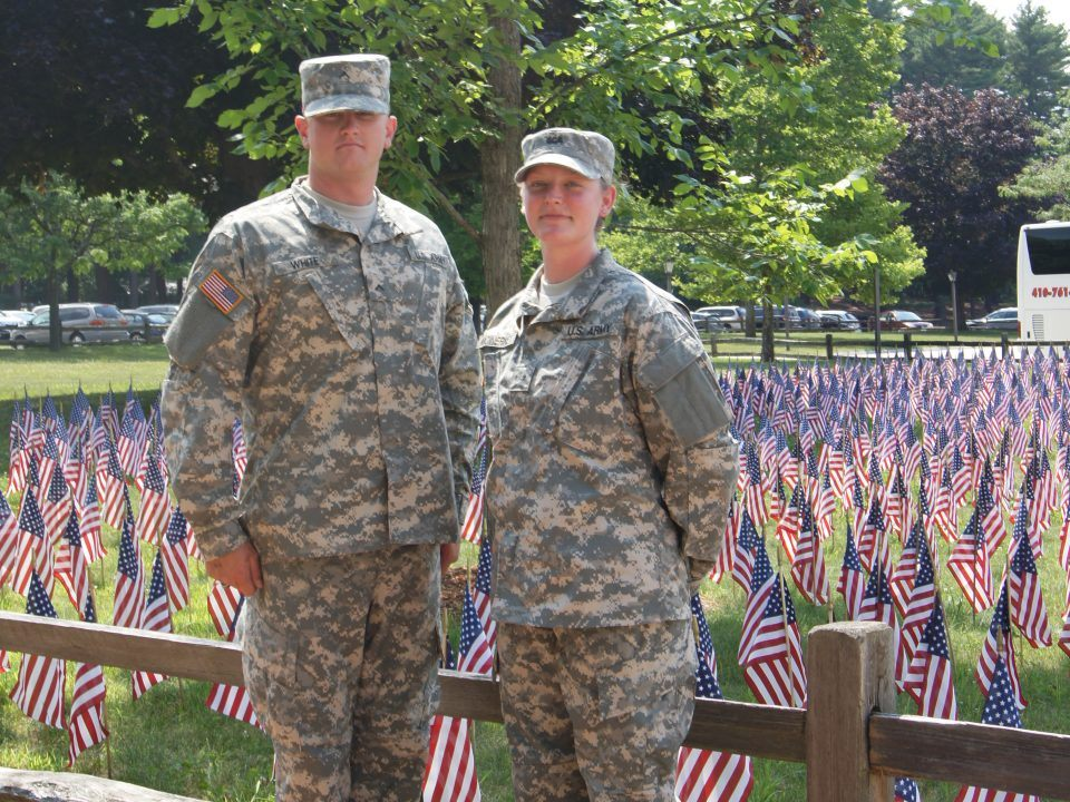 2 Service Members in uniform at the Village