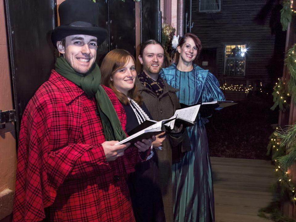 Victorian carolers performing at Christmas by Candlelight