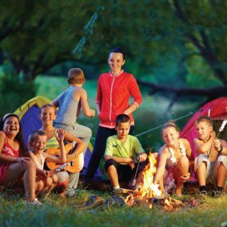 Kids sitting around a bonfire