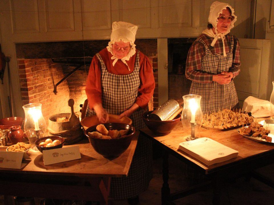 Costumed Historians prepare Christmas Dinner like the Cratchit family did in Charles Dickens' A Christmas Carol