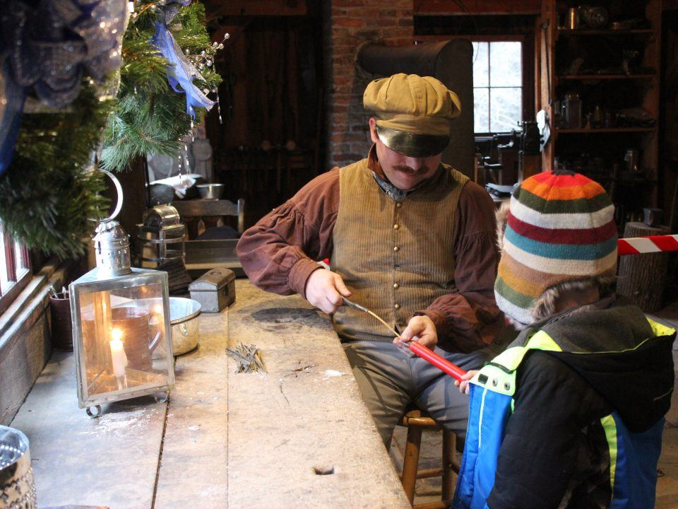 Making tin icicle ornaments in the Tin shop