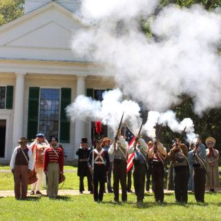 A martial salute in front on the Center Meetinghouse