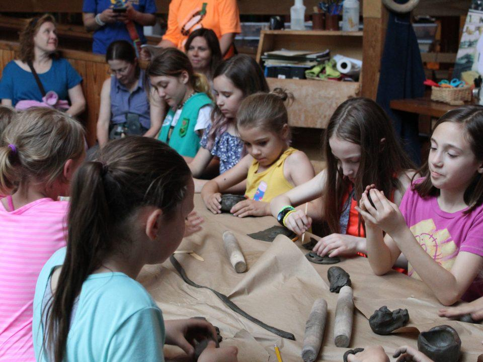Girl Scouts participate in a pottery workshop