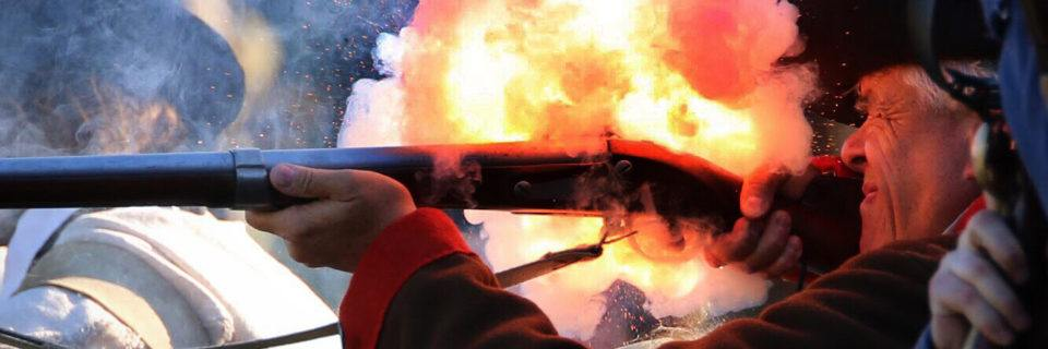 Closeup of a Redcoat shooting a musket