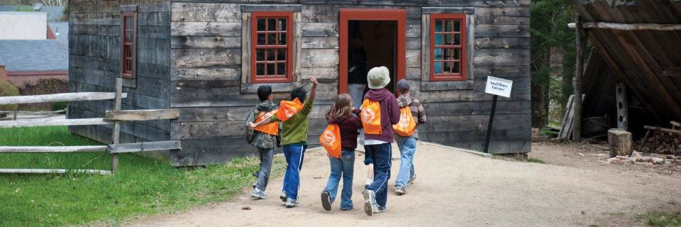 A group of school children about to enter the Small House at Old Sturbridge Village