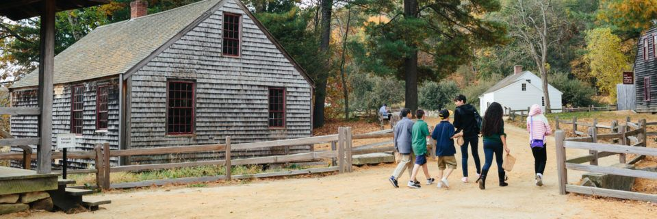 A group of students visit the mills at Old Sturbridge Village