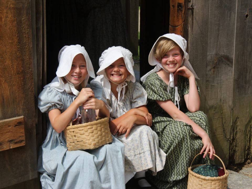 Three girls in costume smiling