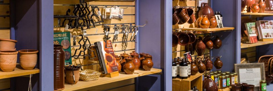 Village made redware pottery for sale in the Museum Store