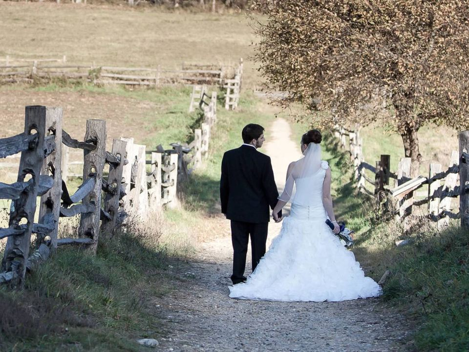 A newly married couple takes a walk in the countryside behind Freeman Farm