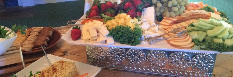Cheese and fruit trays at a function