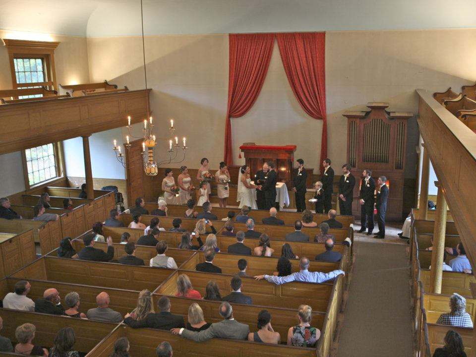 A wedding ceremony in the Center Meetinghouse at Old Sturbridge Village