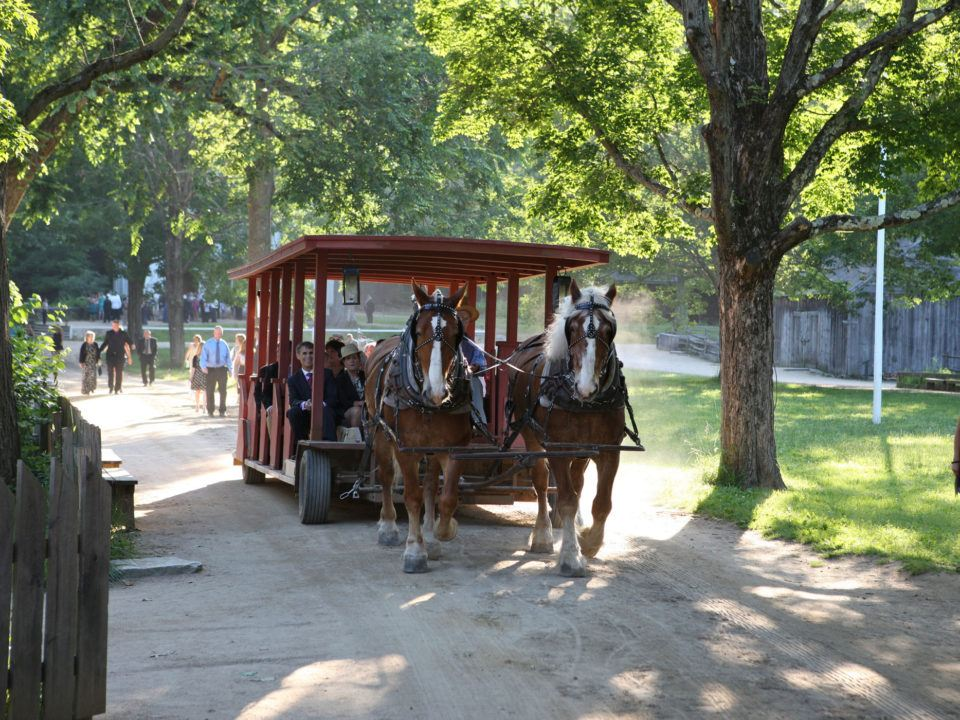 The horse-drawn carryall wagon is available to bring guests from the entrance of the museum to the ceremony or reception site within the Village