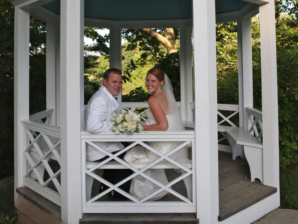 A newly married couple sits in a gazebo in the Salem Towne Garden