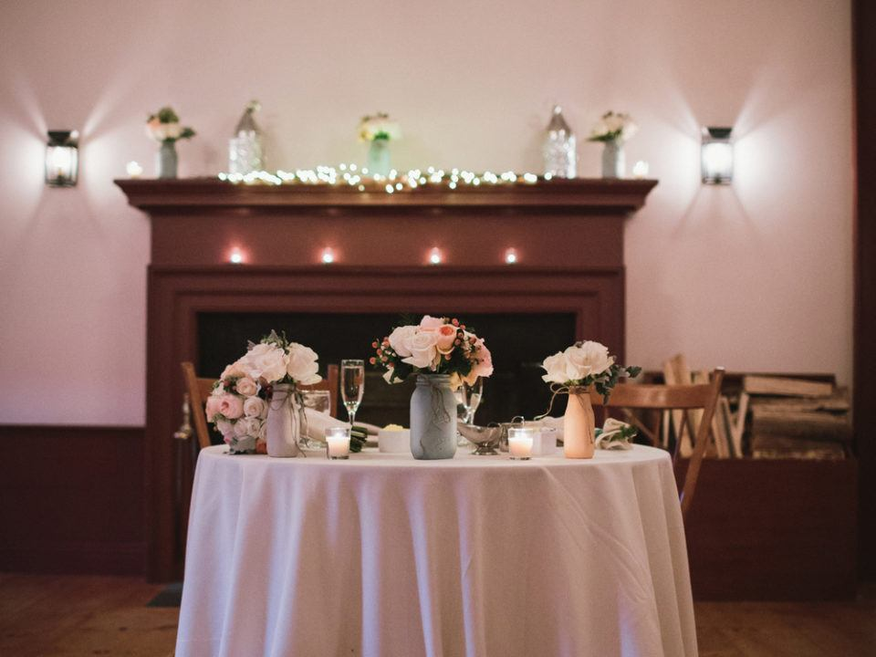 A sweetheart table set up for the happy couple at a wedding reception in the Oliver Wight Tavern