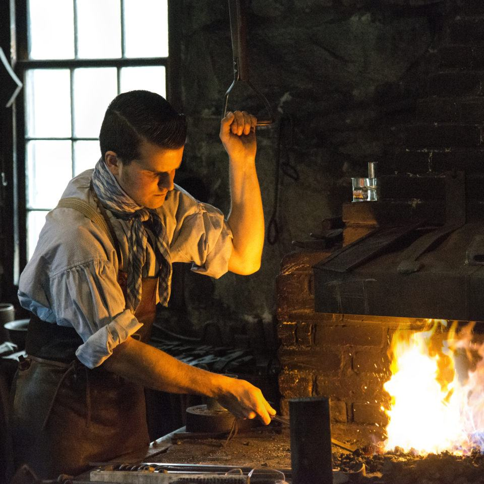 Derek working in the Blacksmith Shop