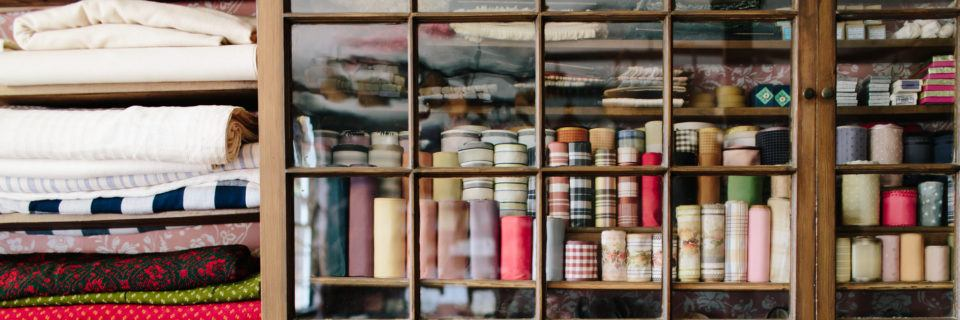 Fabric and trim on the shelves in the Asa Knight Store