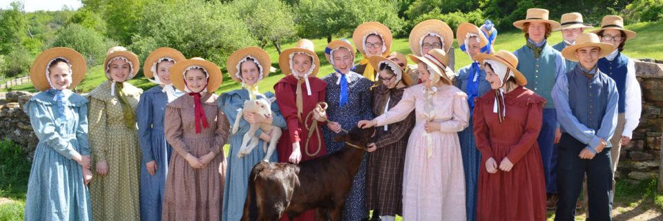 A group of junior (high school) interns in costume at the Freeman Farm