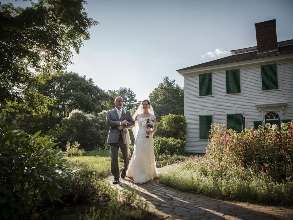 A newly married couple walk in the Salem Towne Garden