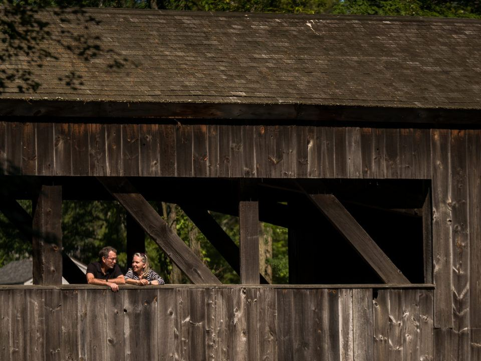 A couple visits the Quinebaug River Bridge