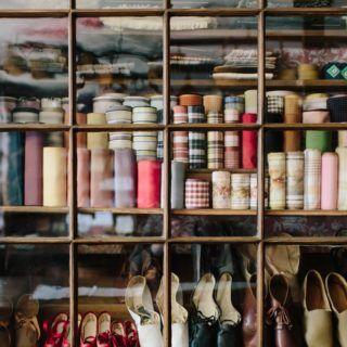 Ribbons, shoes, and accessories on display in the Asa Knight Store