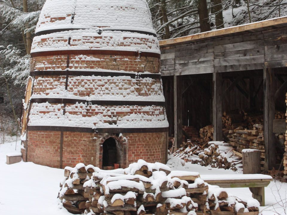 The Kiln and woodpile covered in fresh snow