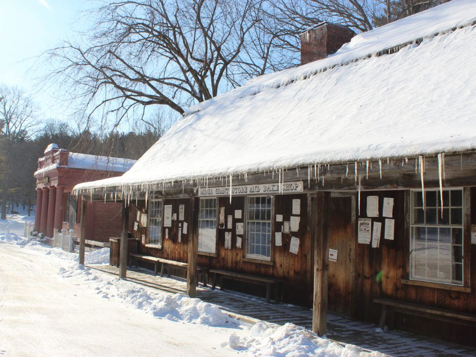 The Miner Grant Store with fresh snow and icicles on the roof