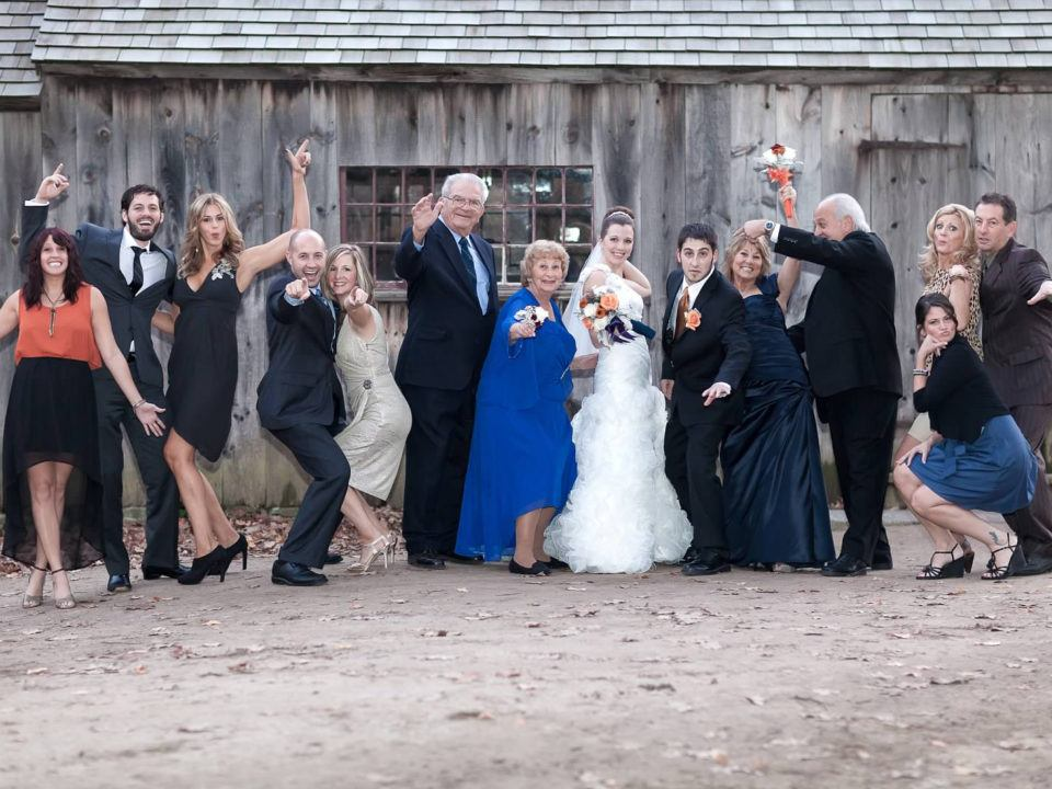A wedding party takes a silly photo