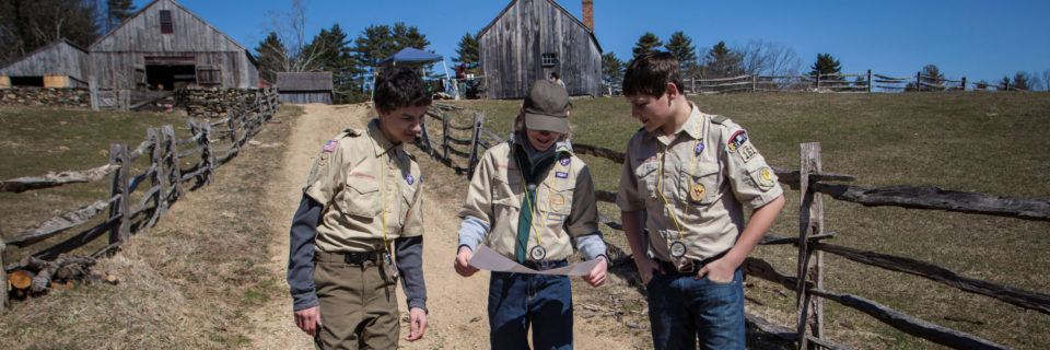 3 Boy Scouts in uniform explore Old Sturbridge Village