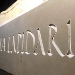 letters carved in stone