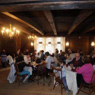 Families eating in the Bullard Tavern Great Room