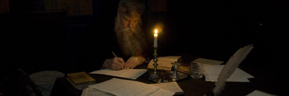 A man works by candlelight