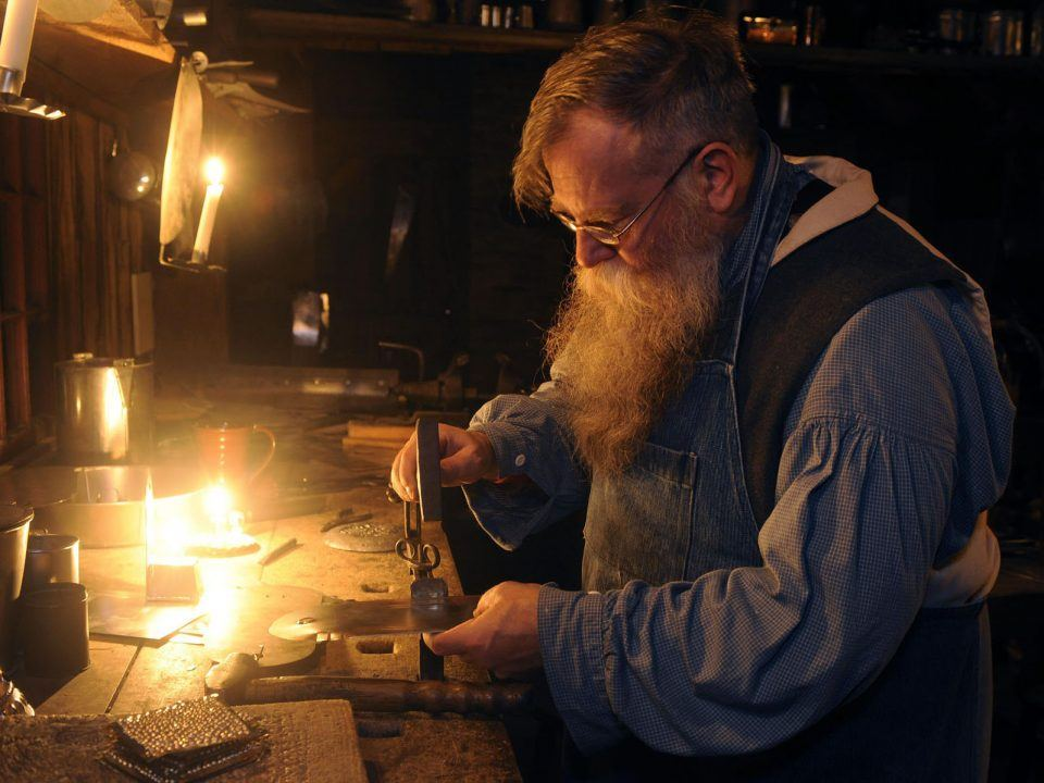 Working in the Tin shop by Candlelight