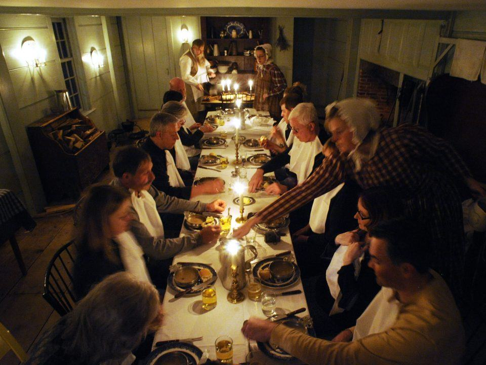 Participants sit down for dinner in the Parsonage
