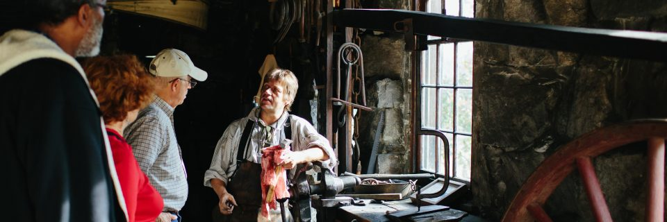 Guests visiting the Blacksmith Shop