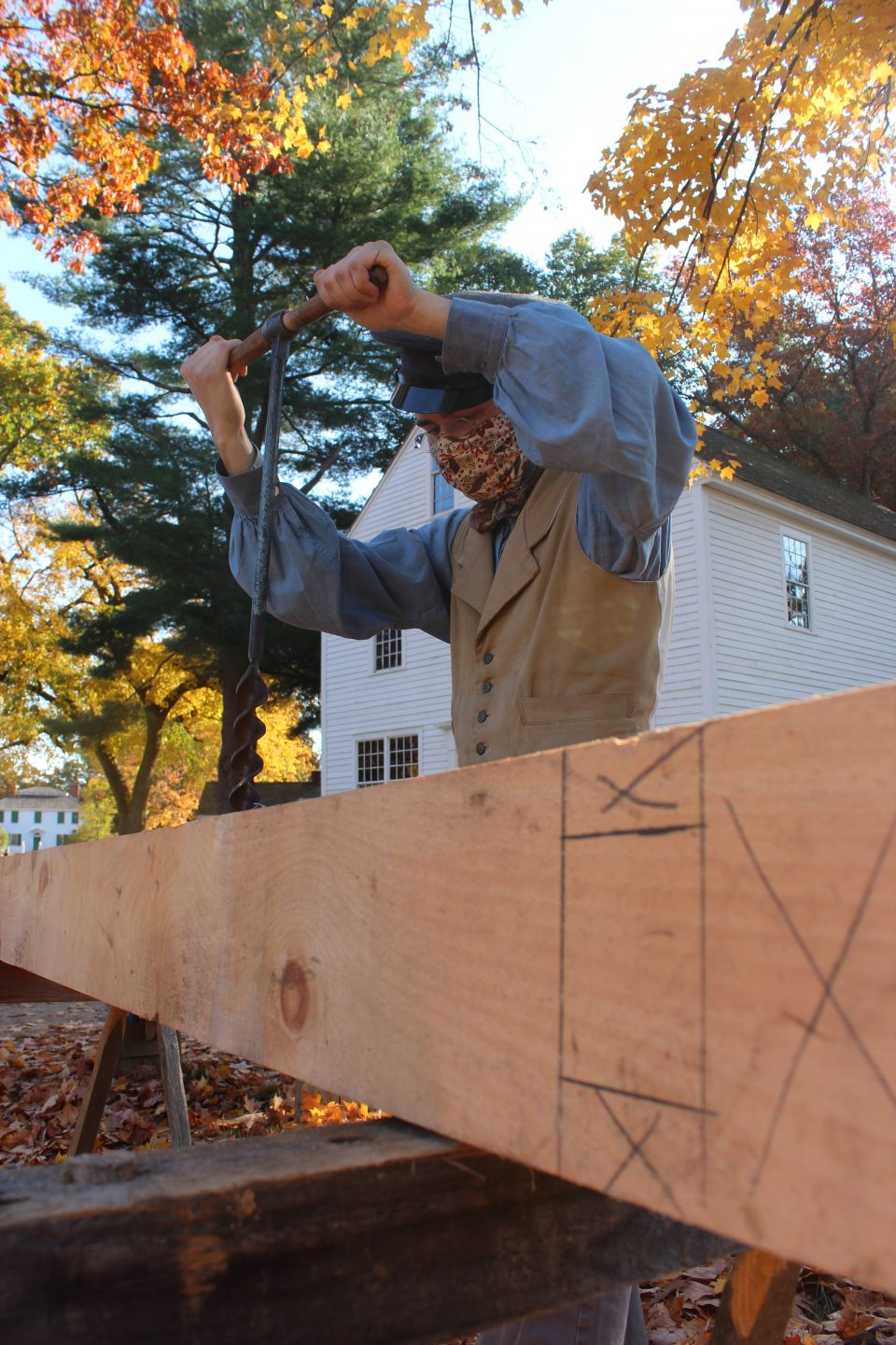 Using a auger on a beam for the Cabinetmaking Shop