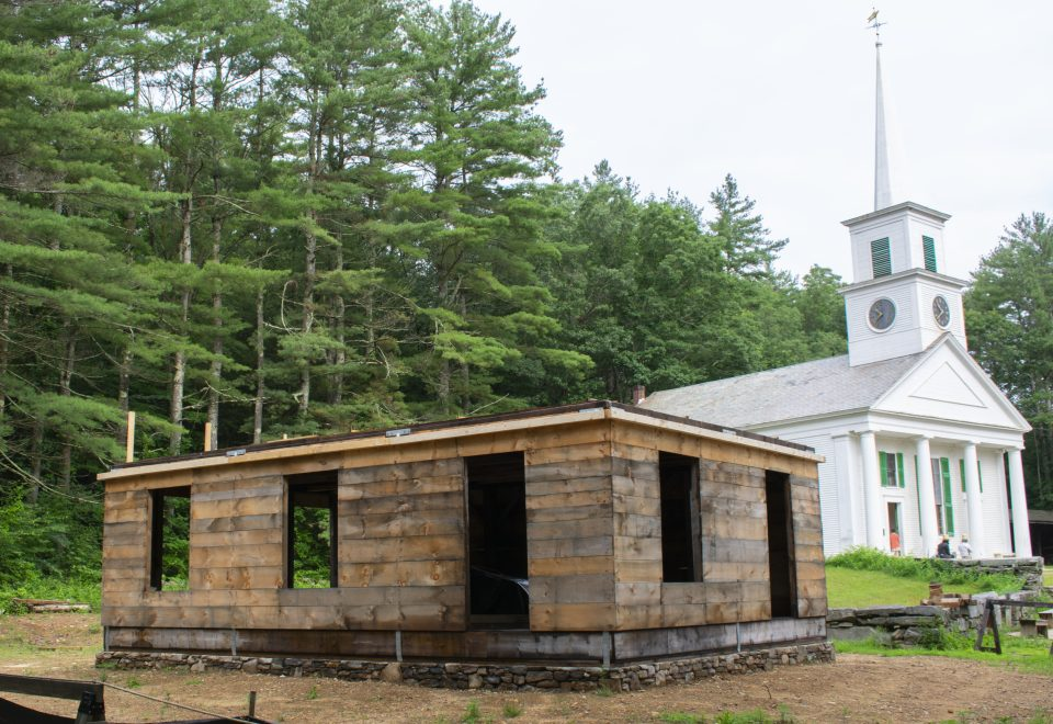 Showing the Cabinetmaking Shop building in progress. Walls are up!