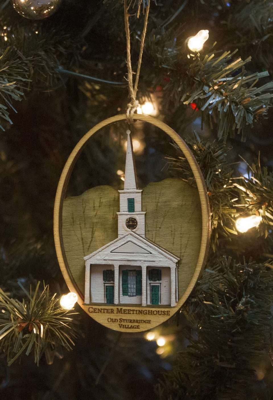 wooden carved ornament of the Center Meetinghouse at the Village