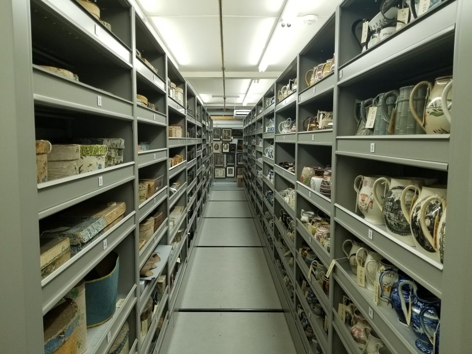View of expanding shelves in Collections storage, filled with artifacts from the 19th century